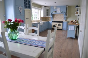 Blue and white painted shaker kitchen with quartz worktop